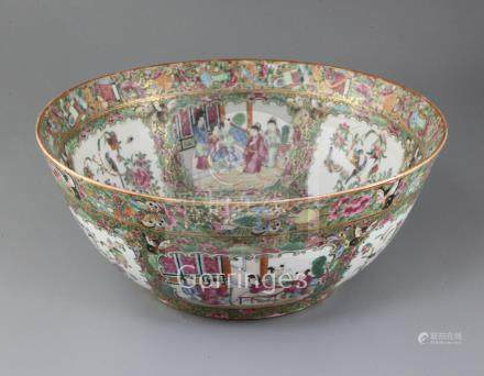 A Chinese famille rose bowl, 19th century, painted with figures amid pavilions and birds amid