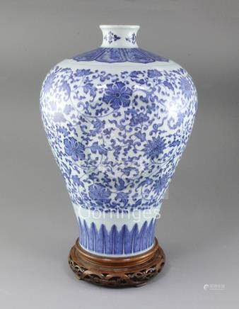 A large Chinese blue and white meiping, painted with lotus flowers and scrolling foliage in