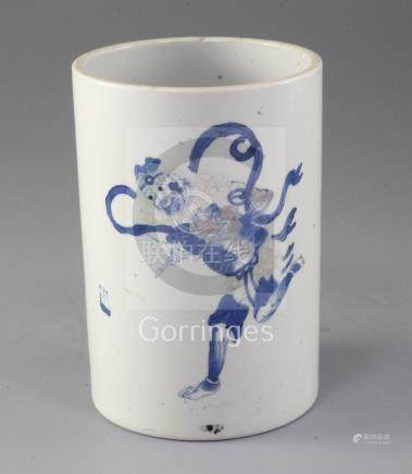 A Chinese underglaze blue and copper red brush pot, late 19th century, painted with the figure of
