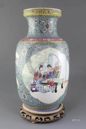 A Chinese famille rose lantern shaped vase, Republic period, painted with children and ladies in