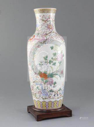 A Chinese famille rose baluster vase, painted with chrysanthemums amid rockwork, on a ground painted