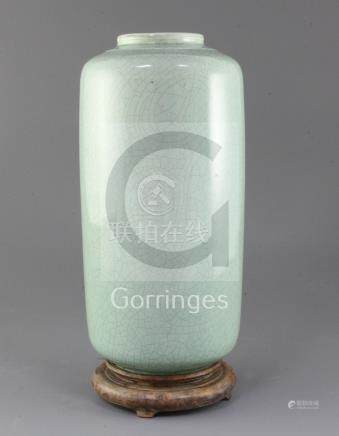 A Chinese pale green crackle glazed cylindrical vase, probably 19th century, 31.5cm, wood stand