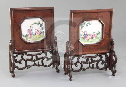 A pair of Chinese carved and pierced hardwood table screens, 19th century, inset with octagonal