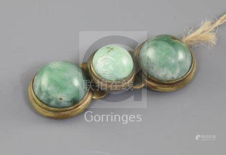 A Chinese gilt metal and jadeite mounted belt buckle, 19th century, 9cm long