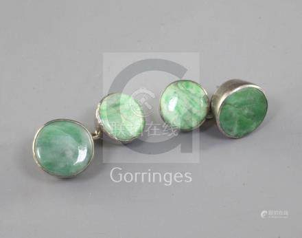 A pair of Chinese jadeite and silver mounted cuff links, late 19th/early 20th century, with chain