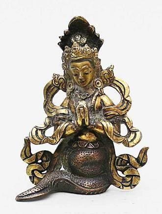 Buddha als Naga (Schlangengott).Partiell feuervergoldete Bronze, 216 g. Tibet, 19. Jh. H. 9 cm.