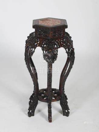 A Chinese dark wood hexagonal shaped jardiniere stand, Qing Dynasty, the hexagonal shaped top with a