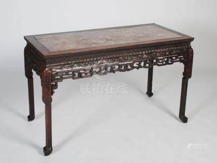 A Chinese rectangular dark wood table, Qing Dynasty, the rectangular shaped top with a mottled red