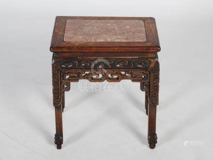 A Chinese dark wood jardiniere stand, late Qing Dynasty, the rectangular top with a mottled red