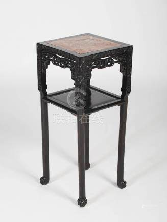 A Chinese dark wood jardiniere stand, Qing Dynasty, the square shaped top with a mottled red and