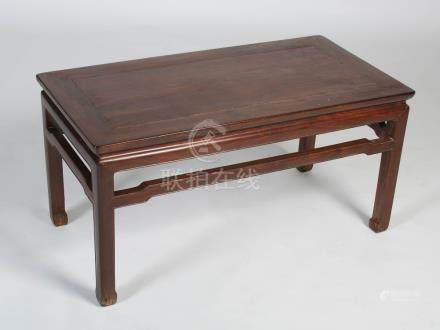 A Chinese dark wood Kang table, late Qing Dynasty, the rectangular panel top raised on four square