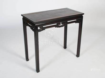 A Chinese black wood rectangular table, late Qing Dynasty, the rectangular panel top above a pierced