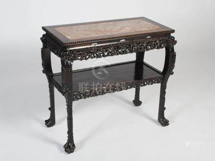 A Chinese dark wood rectangular table, Qing Dynasty, the rectangular top with mottled red and