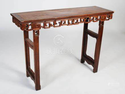 A Chinese dark wood rectangular table, late Qing Dynasty, the rectangular panel top above a
