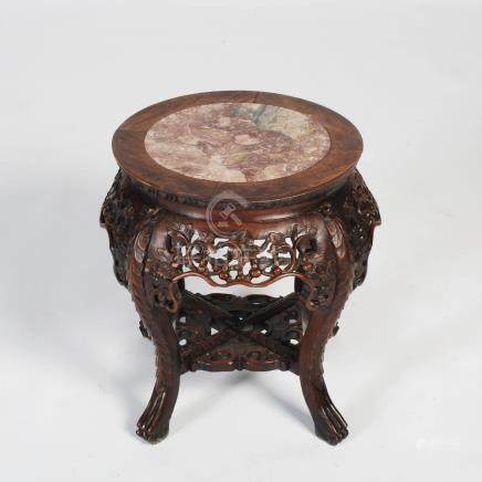 A Chinese dark wood jardiniere stand, Qing Dynasty, the circular top with mottled red and white