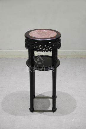 A Chinese dark wood jardiniere stand, Qing Dynasty, the circular top with a red and white marble