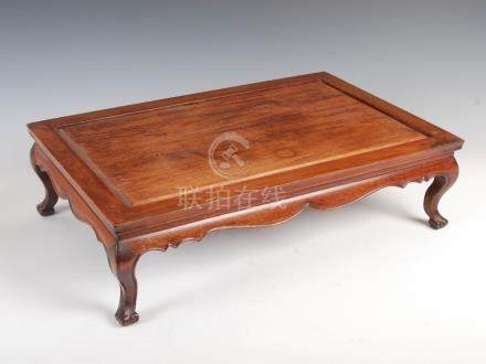 A Chinese dark wood miniature table, late Qing Dynasty, the rectangular panelled top above a