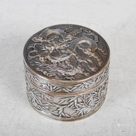 A Chinese silver circular shaped dragon box and cover, late Qing Dynasty, makers mark of WH probably