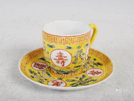 A Chinese porcelain yellow ground teacup and saucer, Guangxu six character mark and of the period,