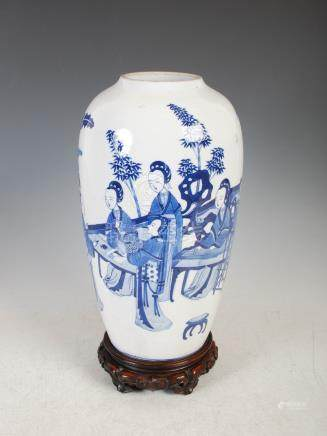 A Chinese blue and white porcelain vase, Qing Dynasty, decorated with ladies in a fenced garden of