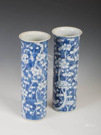 A pair of Chinese porcelain blue and white sleeve vases, Qing Dynasty, decorated with prunus blossom