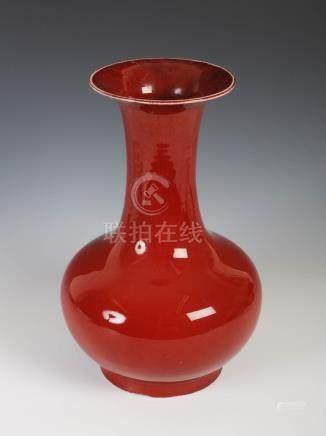 A Chinese porcelain sang-de-boeuf glazed vase, Qing Dynasty, 34.5cm high.