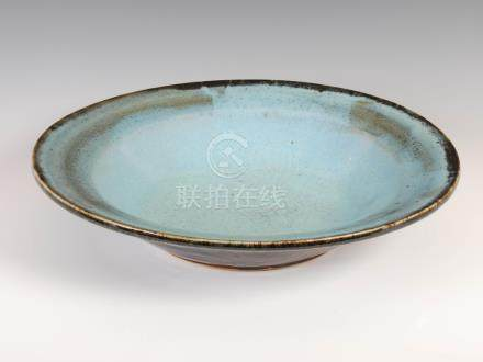 A large Chinese turquoise glazed shallow bowl, with crackle and spotted glaze, 44cm diameter x