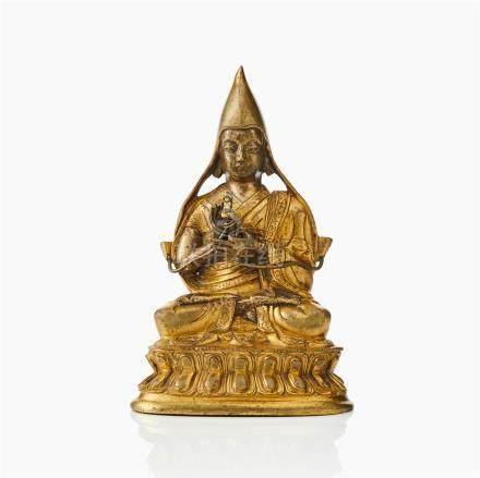 A Tibeto-Chinese gilt bronze figure of Tsongkhapa