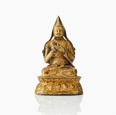 A Mongolian / Kalmykia gilt brass repousse figure of Tsongkhapa