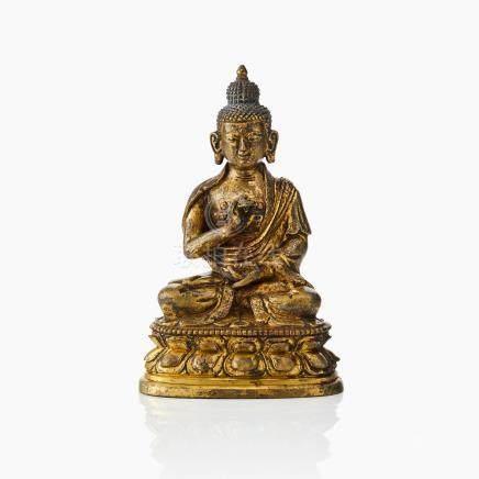 A Tibeto-Chinese gilt bronze figure of Shakyamuni Buddha