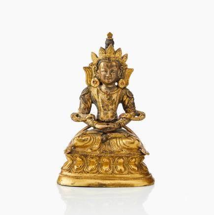 A Tibeto-Chinese gilt bronze figure of Amitayus