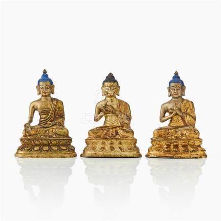 Three Tibeto-Chinese gilt bronze Buddha figures