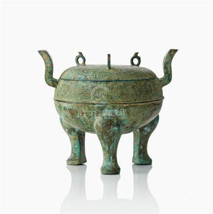 A bronze ritual food vessel and cover