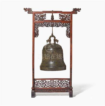 An imposing large bronze bell on wood stand