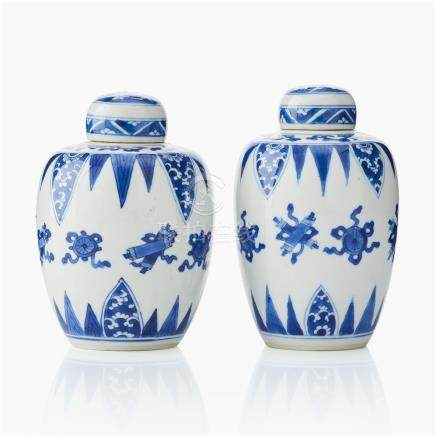 Two blue and white vases and covers