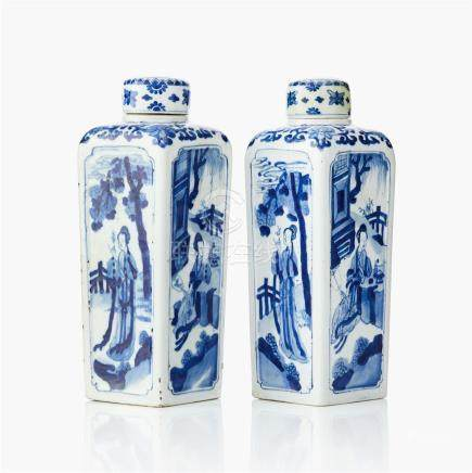 A pair of blue and white 'gin bottle' flasks and covers