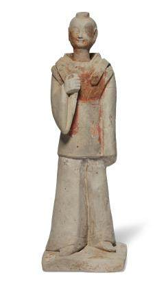 A GREY POTTERY FIGURE OF A DIGNITARY