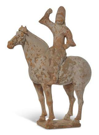A PAINTED POTTERY FIGURE OF AN EQUESTRIAN