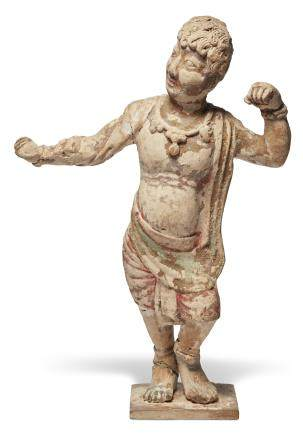 A POTTERY FIGURE OF A DANCING FOREIGNER