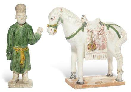 A GLAZED POTTERY GROOM AND A HORSE