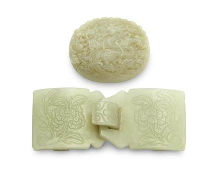 A WHITE JADE BELT BUCKLE AND A GREYISH-WHITE JADE `DRAGON' PLAQUE