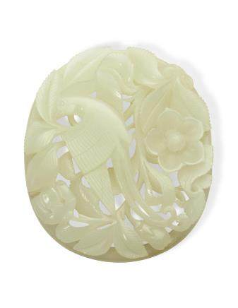 A WHITE JADE RETICULATED 'BIRD AND FLOWER' PLAQUE