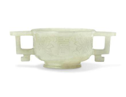 A PALE GREENISH-WHITE JADE TWIN-HANDLED CUP