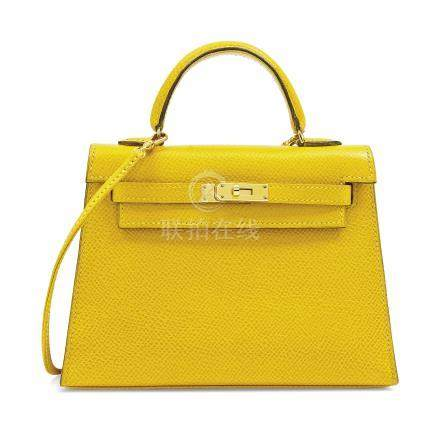 A JAUNE COURCHEVEL LEATHER MICRO MINI KELLY 15 WITH GOLD HARDWARE