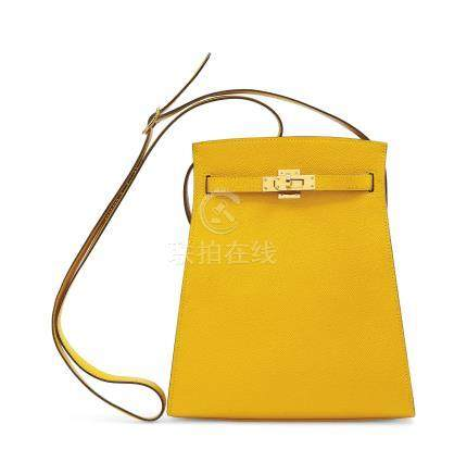 A JAUNE COURCHEVEL LEATHER KELLY SPORT WITH GOLD HARDWARE