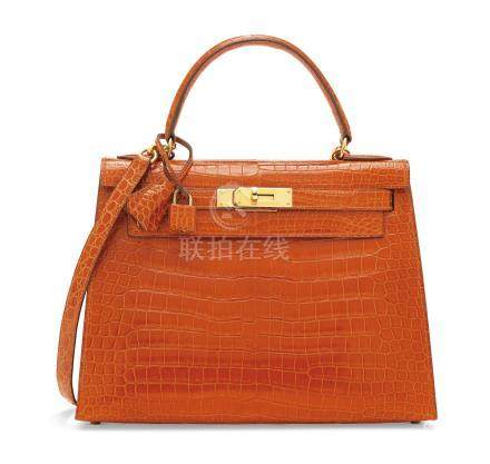 A SHINY ORANGE H POROSUS CROCODILE SELLIER KELLY 28 WITH GOLD HARDWARE