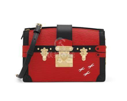 A RED ÉPI LEATHER TRUNK CLUTCH