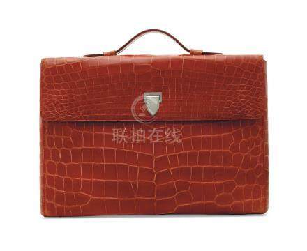 A SHINY RED ALLIGATOR CITY PORTFOLIO CASE WITH SILVER HARDWARE