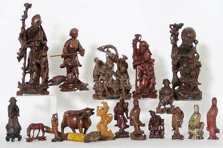 several Chinese sculptures in wood