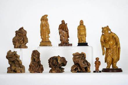 several Chinese sculptures, some in burr wood and some from